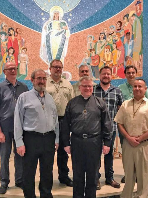 The new leadership: back row, (L-R) Fr. Frank Santucci, Fr. Jim Brobst, Fr. Art Flores, Fr. Ray Cook, Treasurer, Fr. Jim Chambers, Front row (L-R) Fr. Jim Taggart, Provincial, Fr. Louis Studer, Fr. Antonio Ponce