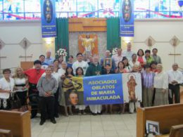 New Associates gather with Fathers Antone and Garcia