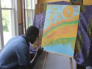Sakala works on a painting