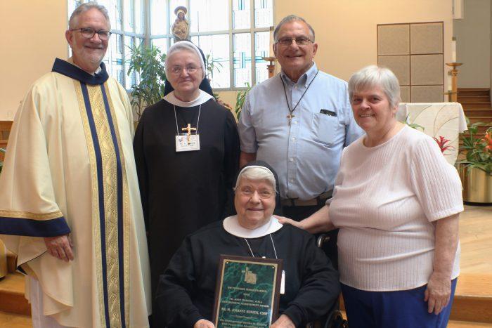 (L-R) Fr. William Antone, OMI, Sr. M. Blaise Surlas, CSSF, Bro. Tom Ruhmann, OMI, Carol Buchla, (Seated) Sr. M. Josanne Buszek, CSSF